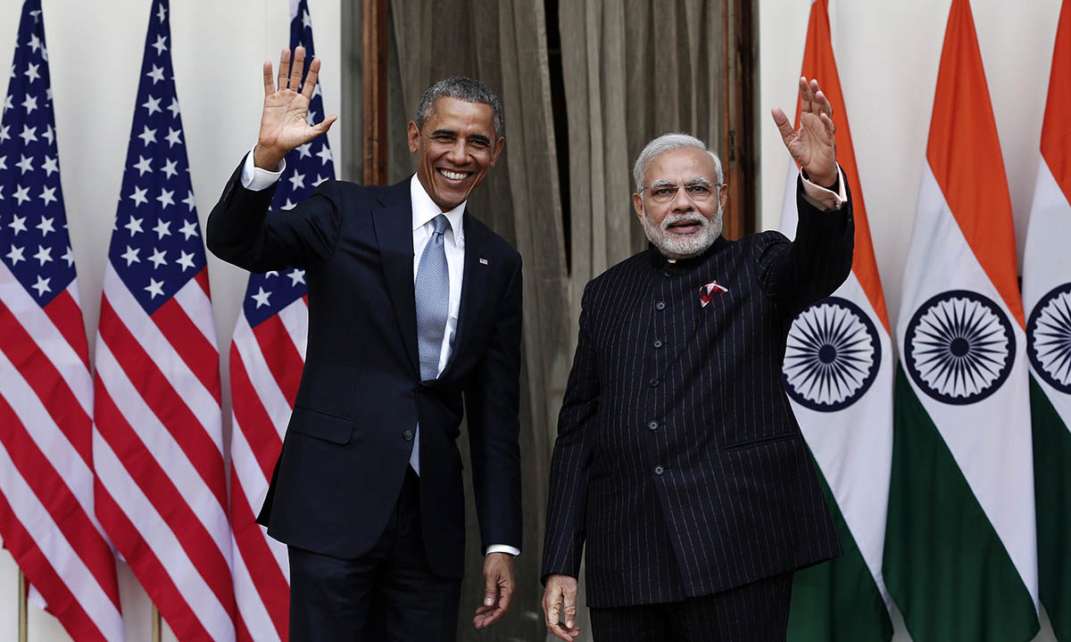 U.S. President Obama and India's Prime Minister Modi wave during a photo opportunity ahead of their meeting at Hyderabad House in New Delhi